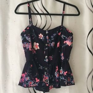 Cute floral tank. Buttons and peplum detail!!!
